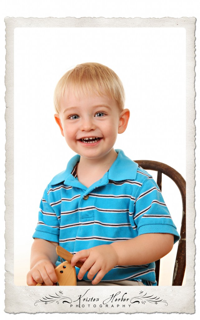 two year boy sitting in chair