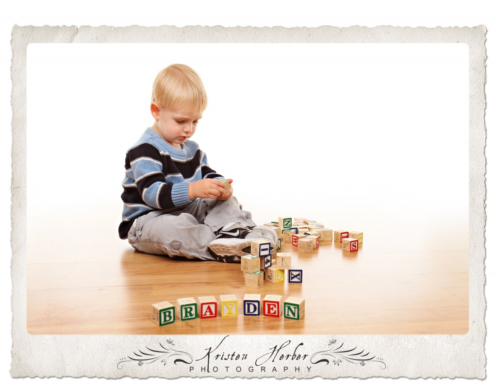 two year old boy with blocks