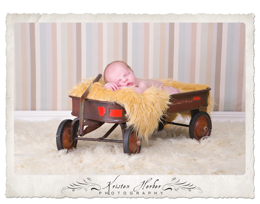 baby boy in radio flyer
