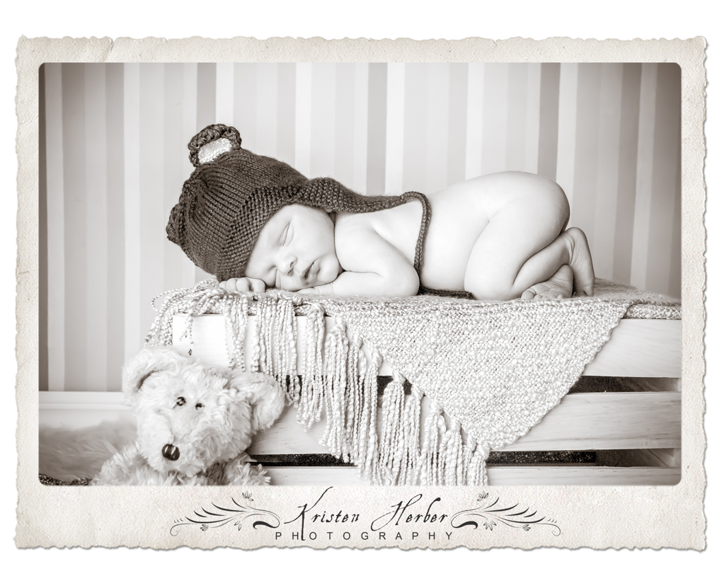 Newborn boy with teddy bears