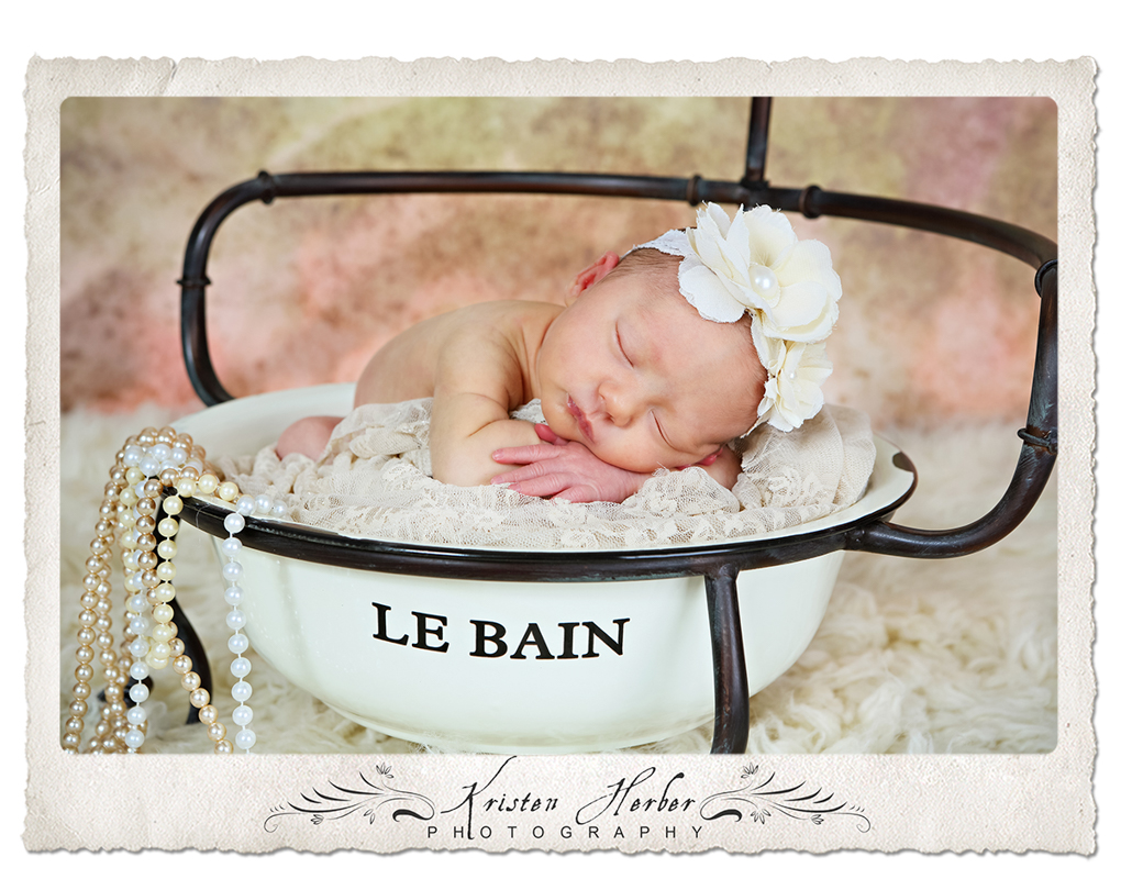 Newborn girl in bath tub
