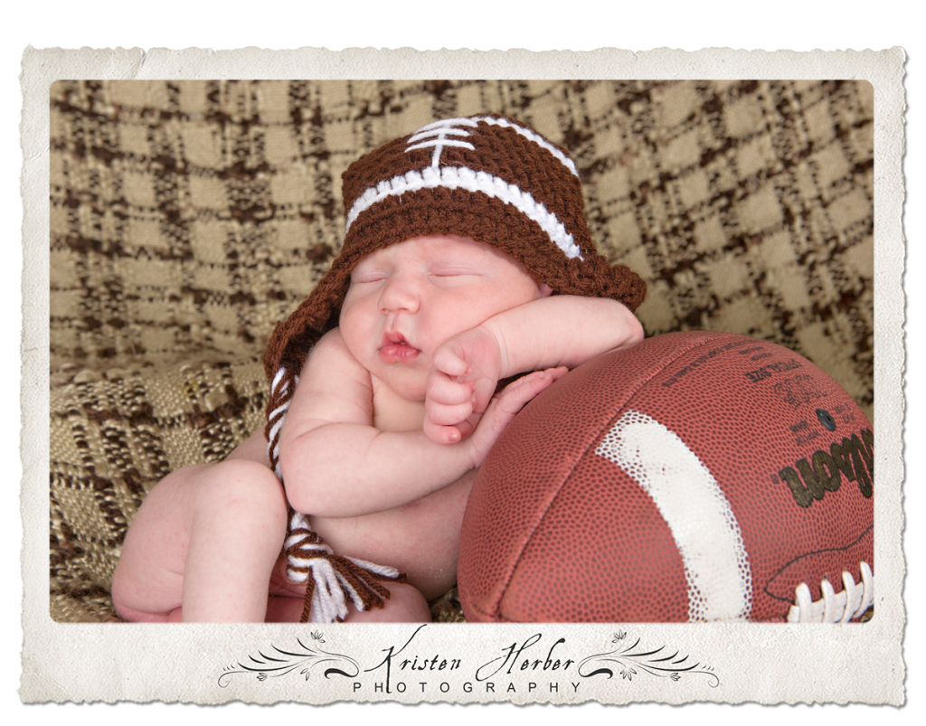 Newborn boy with football