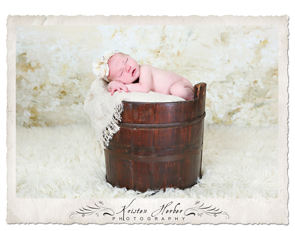 sweet baby girl in old well bucket