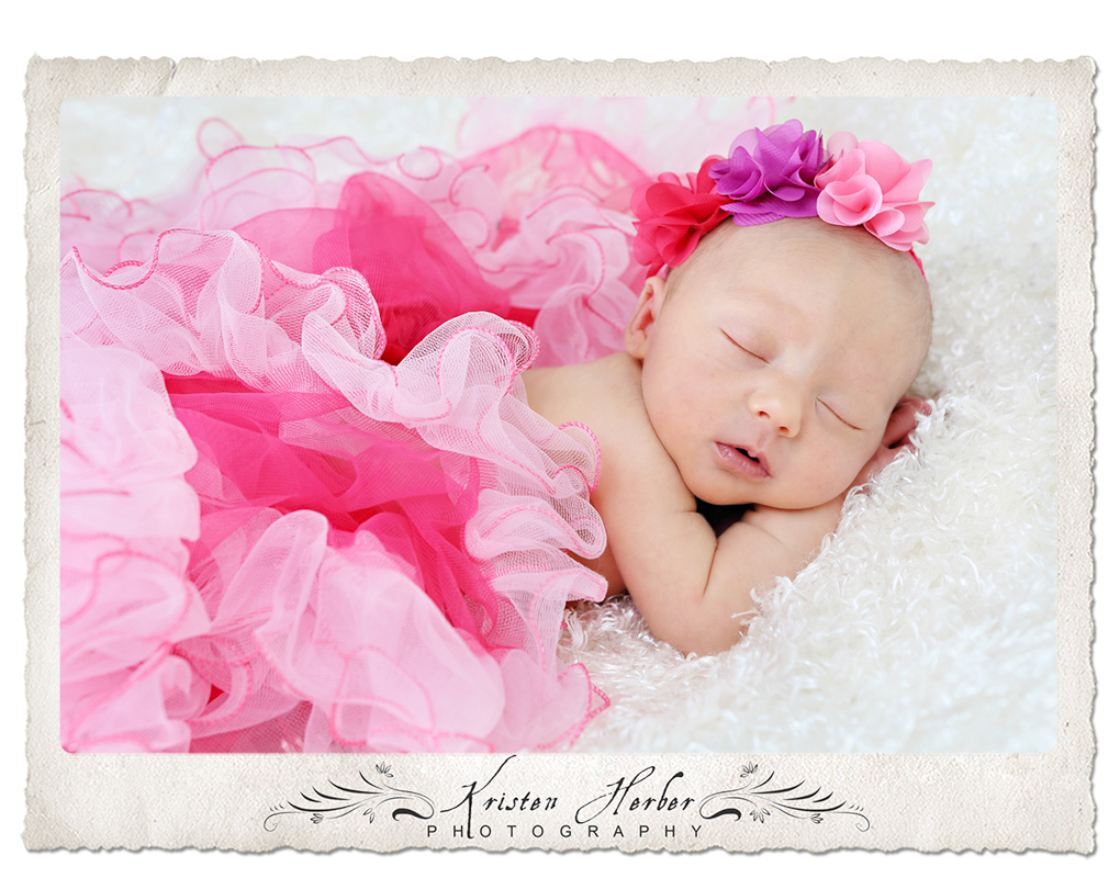Newborn girl wearing hot pink tutu