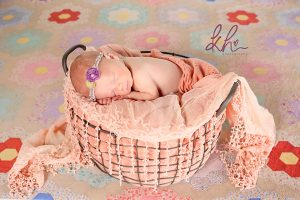 Newborn Baby girl with antique quilt